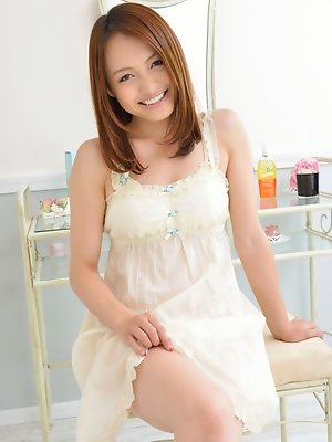 Rina Itoh Asian smiles and shows sexy legs under cute dress