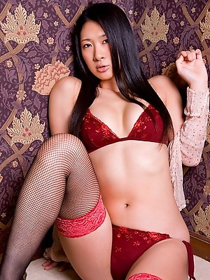 Spicy asian hottie steams up the place in her black stockings