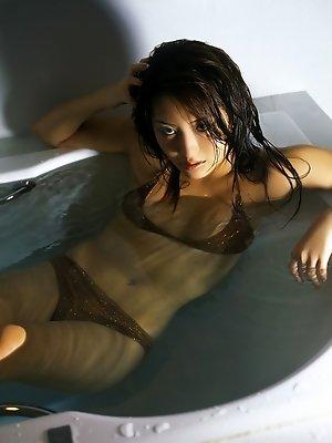 Haruna Yabuki sexy Asian babe wearing a bikini in the bathtub