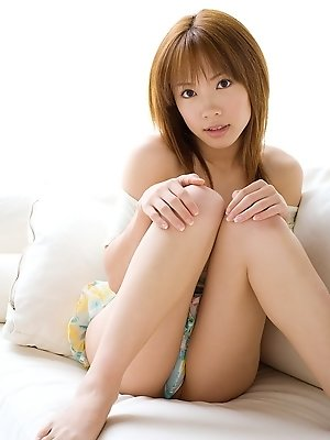 Rika Yuuki Asian model enjoys showing her lingerie clad body and smile