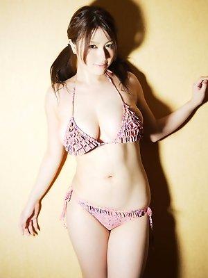 Ivory skinned asian beauty shows off her big milky tits in bikini